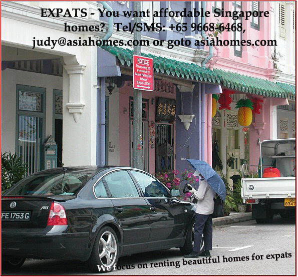 Singapore traffic warden using a PDA - Asiahomes.com rental advert