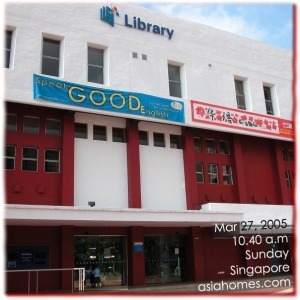 Small boy waiting for the library to open on a Sunday in Singapore